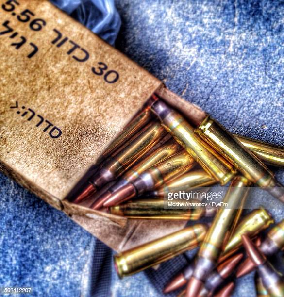 High Angle View Of Bullets On Fabric