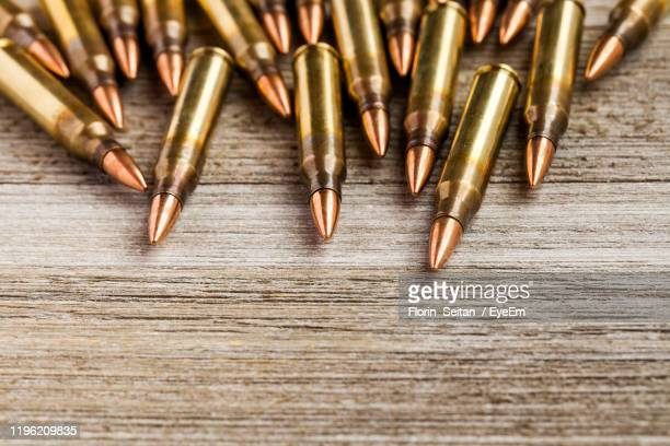 high angle view of bullets on table - florin seitan stock pictures, royalty-free photos & images