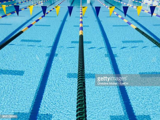 high angle view of buntings hanging over swimming pool - length stock pictures, royalty-free photos & images