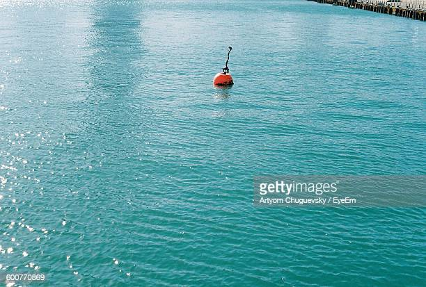 High Angle View Of Buoy Floating On Sea