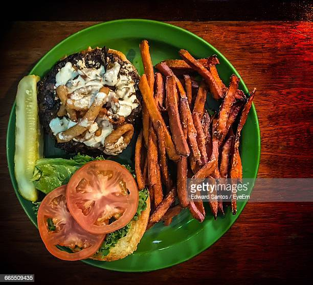 High Angle View Of Burger With French Fries On Table