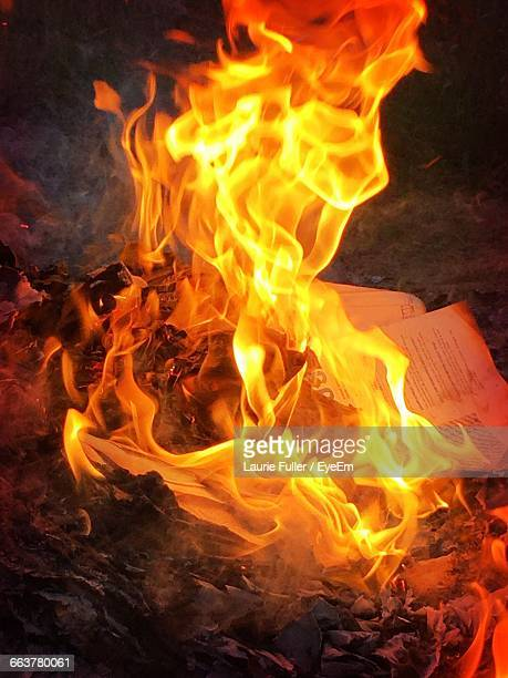 High Angle View Of Burning Papers