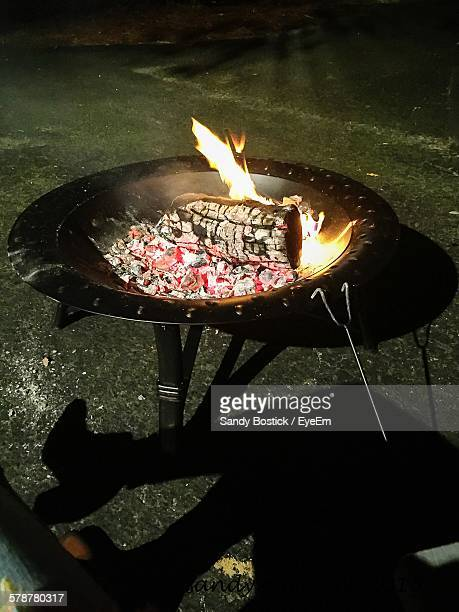 High Angle View Of Burning Wood In Barbecue Grill