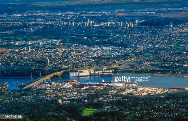 High angle view of Burrard Inlet with the Second Narrows Bridge also called Ironworkers Memorial Bridge. North Vancouver in foreground, Burnaby and New Westminster in backdrop