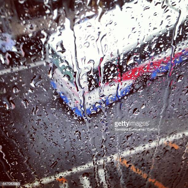 high angle view of bus on road seen through wet glass window - chiba bus ストックフォトと画像