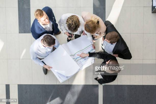 High angle view of business people in office hallway