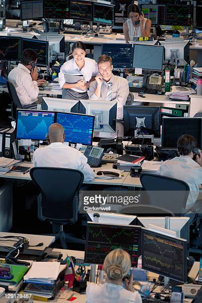 high angle view of business people in office - stock trader stock pictures, royalty-free photos & images