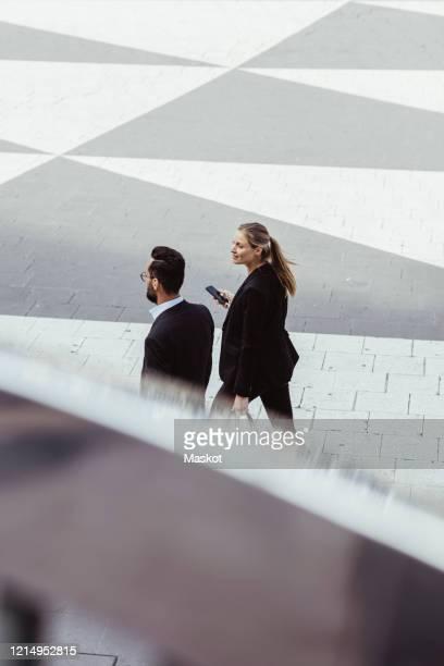 high angle view of business people walking and talking outdoors - finanzen und wirtschaft stock-fotos und bilder
