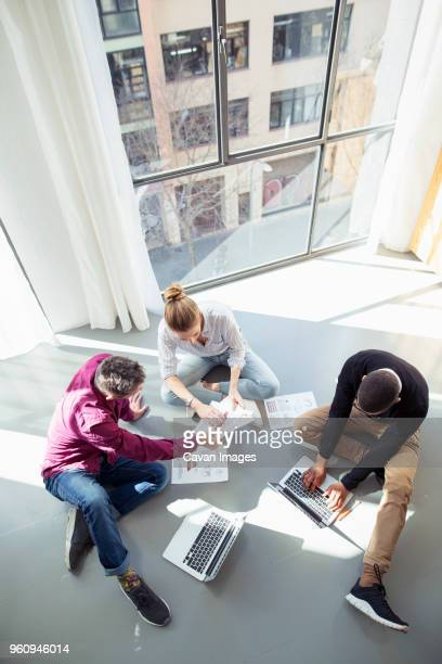 High angle view of business people working by window in office
