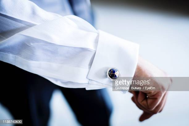 high angle view of businessman showing cuff link - 袖口 ストックフォトと画像