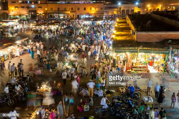 High angle view of bustling traditional North African market square in the evening.