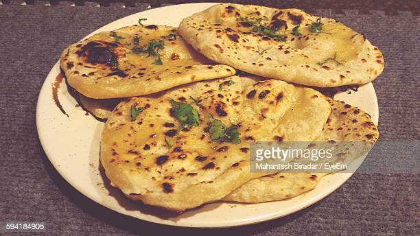 High Angle View Of Butter Naans Served On Table