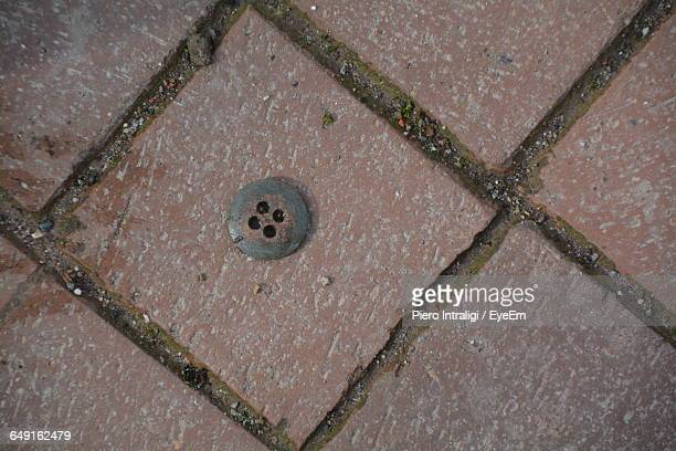 High Angle View Of Button On Footpath