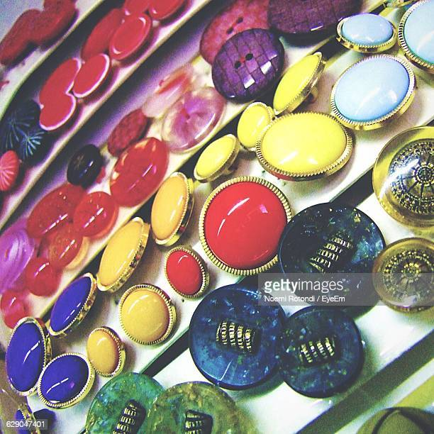 high angle view of buttons for sale - noemi foto e immagini stock