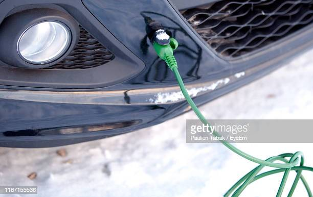 high angle view of cable connected in car - paulien tabak stock pictures, royalty-free photos & images