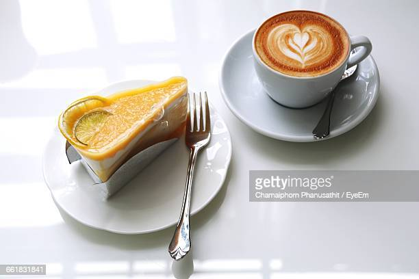 High Angle View Of Cake And Coffee Served On Table