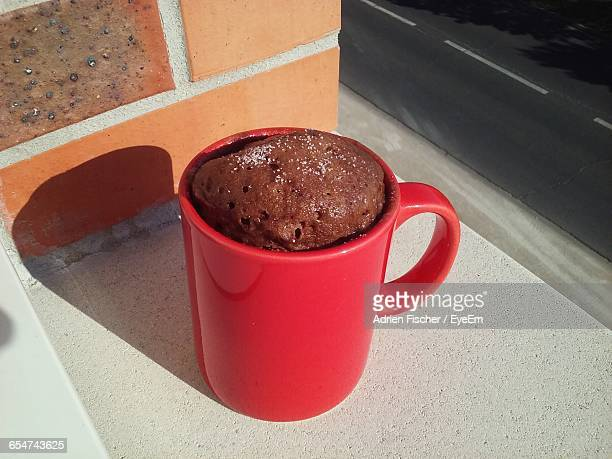 high angle view of cake in mug by road - mug stock pictures, royalty-free photos & images