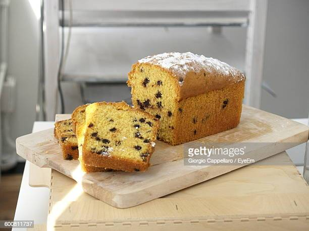 High Angle View Of Cake On Cutting Board