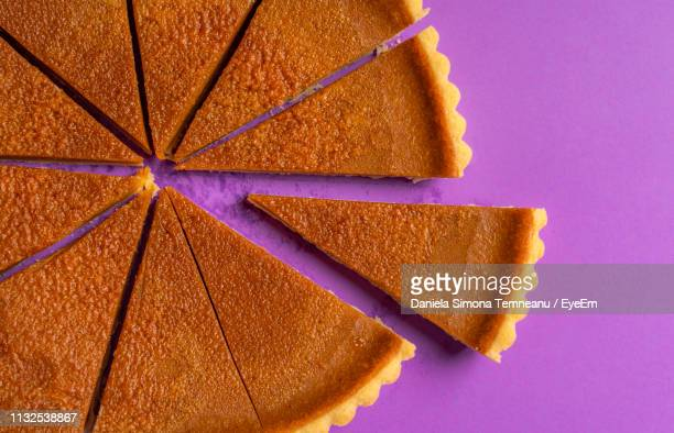 high angle view of cake on purple table - パイ ストックフォトと画像