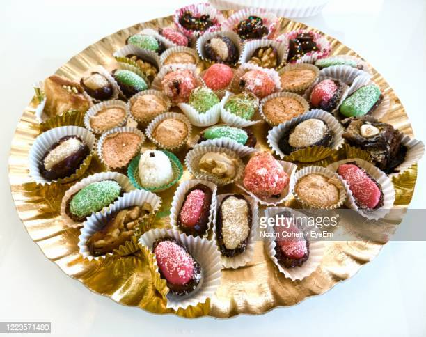 high angle view of cake on table - noam cohen stock pictures, royalty-free photos & images