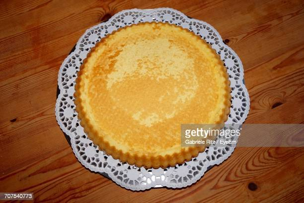 high angle view of cake on wooden table - doily stock photos and pictures