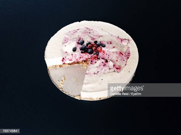 high angle view of cake over black background - danielle reid stock pictures, royalty-free photos & images