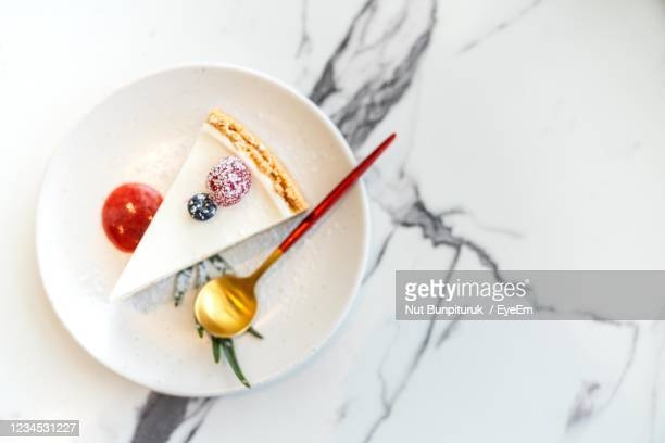 high angle view of cake served on plate - チーズケーキ ストックフォトと画像