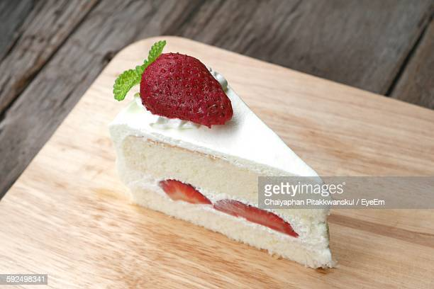 High Angle View Of Cake Slice On Table