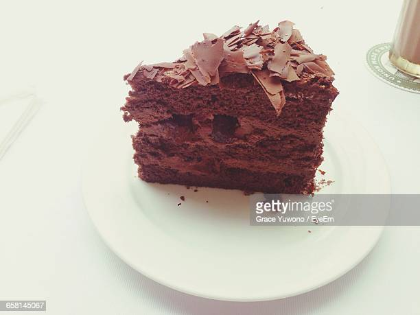 High Angle View Of Cake Slice Served In Plate On Table