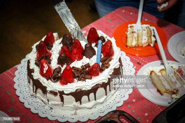 high angle view of cake with knife on table - andres ruffo stock pictures, royalty-free photos & images