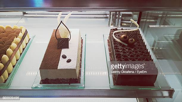 High Angle View Of Cakes In Retail Display At Shop