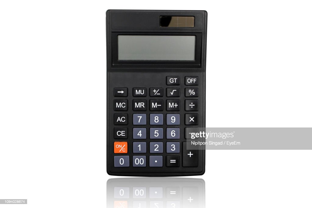 High Angle View Of Calculator Against White Background : Stock Photo
