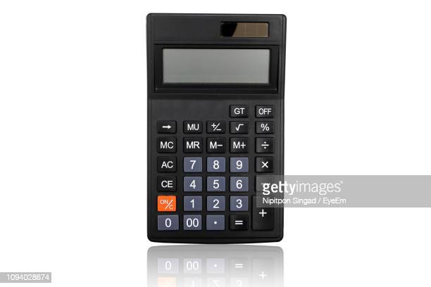 high angle view of calculator against white background - calculator stock photos and pictures