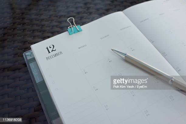 high angle view of calendar in diary - binder clip stock pictures, royalty-free photos & images