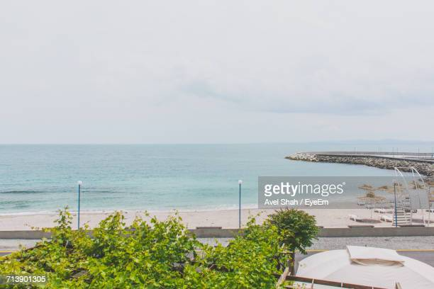 High Angle View Of Calm Sea Against Cloudy Sky