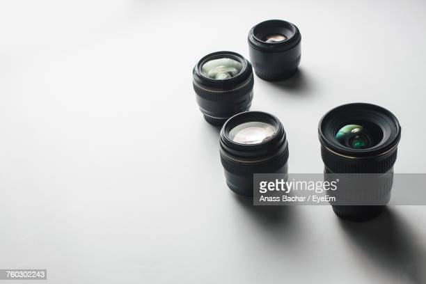 High Angle View Of Camera Lenses Over White Background