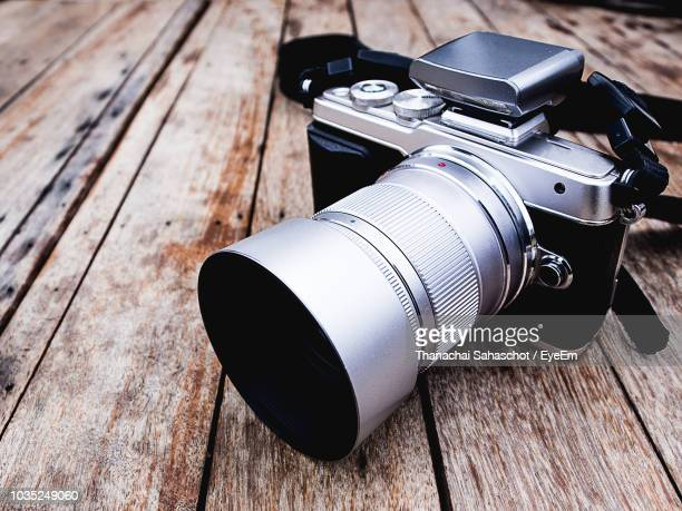 high angle view of camera on table - digital camera stock pictures, royalty-free photos & images