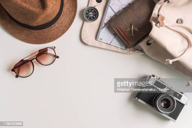 high angle view of camera with personal accessories on table - personal accessory stock pictures, royalty-free photos & images