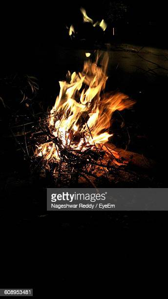 High Angle View Of Campfire On Field At Night