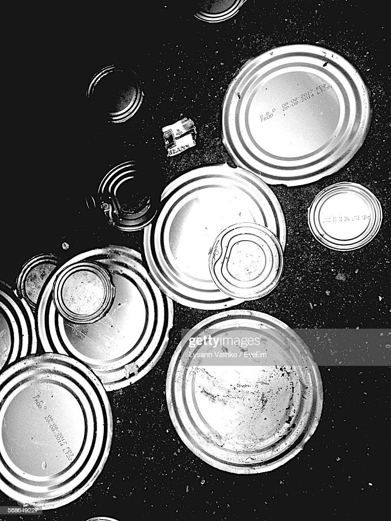 High Angle View Of Can Lids On Street : Stock Photo