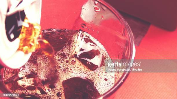 High Angle View Of Can Pouring Drink In Glass