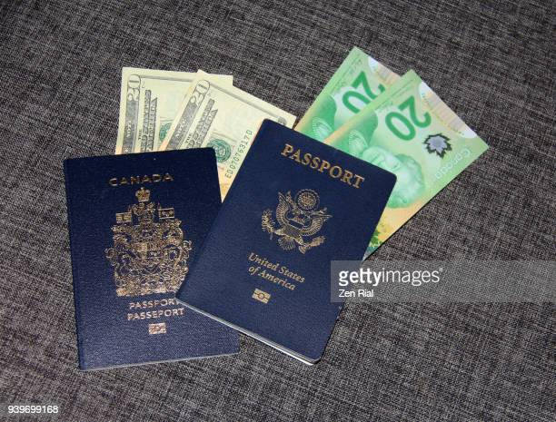 high angle view of canadian and american (usa) passports and twenty dollar bills - politics and government stock pictures, royalty-free photos & images