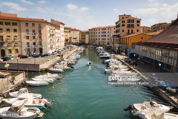 high angle view of canal amidst buildings in city - livorno stock pictures, royalty-free photos & images