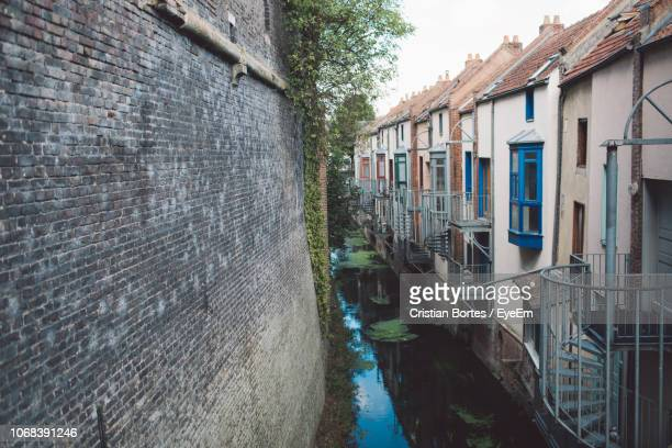 High Angle View Of Canal By Buildings In City