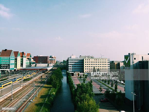 High Angle View Of Canal By Railroad Station Against Sky In City