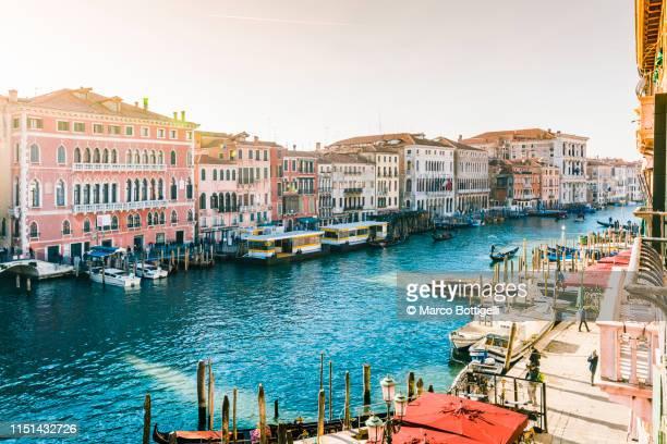 high angle view of canal grande in venice, italy - canale foto e immagini stock