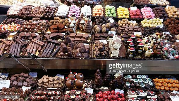 high angle view of candies and chocolates on display in store - chocolate shop stock pictures, royalty-free photos & images