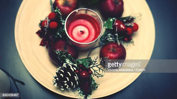 High Angle View Of Candle And Christmas Decoration On Table