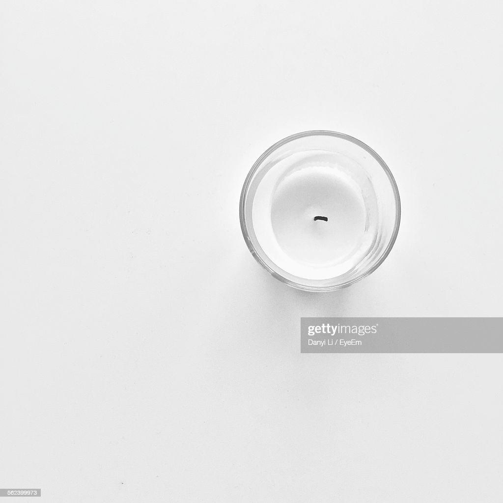 High Angle View Of Candle Over White Background : Stock Photo