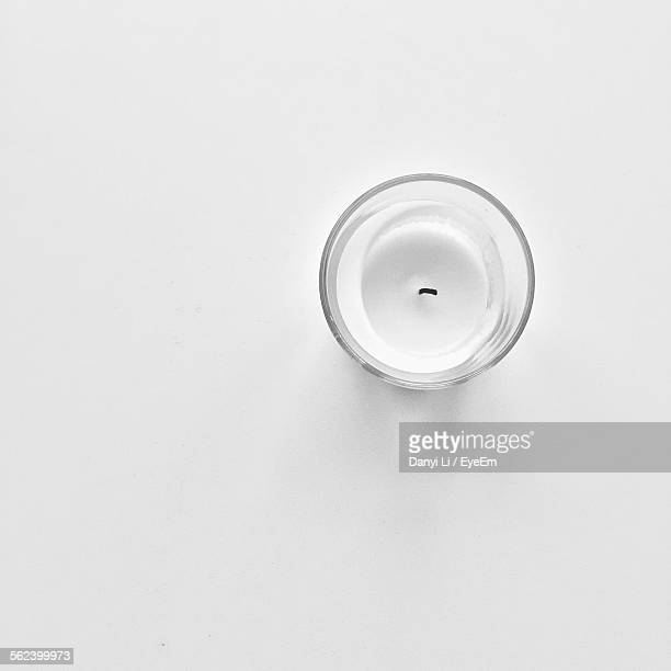 High Angle View Of Candle Over White Background